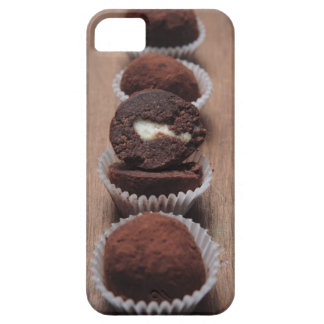 Row of chocolate truffles on wood barely there iPhone 5 case