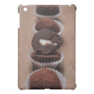 Row of chocolate truffles on wood iPad mini cover