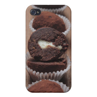 Row of chocolate truffles on wood iPhone 4/4S case