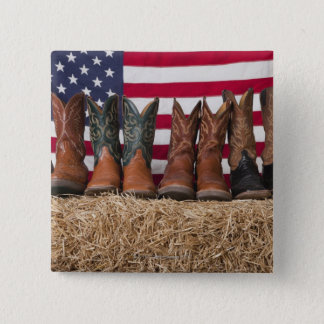 Row of cowboy boots on haystack 15 cm square badge