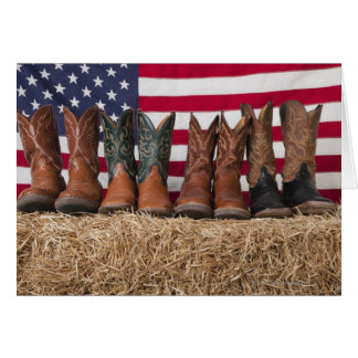Row of cowboy boots on haystack cards