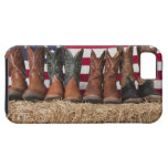 Row of cowboy boots on haystack case for the iPhone 5