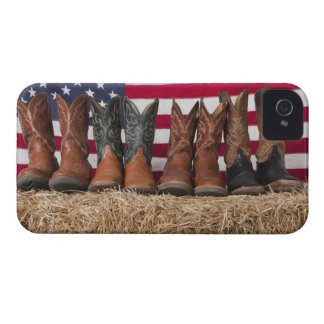 Row of cowboy boots on haystack Case-Mate iPhone 4 cases