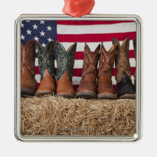 Row of cowboy boots on haystack christmas ornament