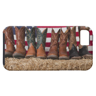 Row of cowboy boots on haystack iPhone 5 cases