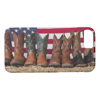 Row of cowboy boots on haystack iPhone 7 case
