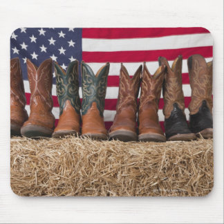 Row of cowboy boots on haystack mouse pad