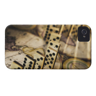 Row of dominoes on old world map 2 iPhone 4 case