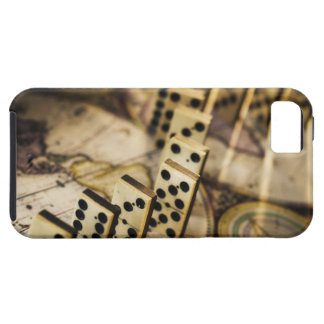 Row of dominoes on old world map 2 iPhone 5 covers