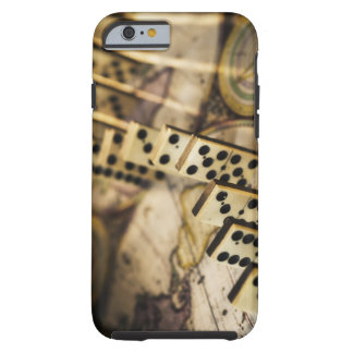 Row of dominoes on old world map 2 tough iPhone 6 case