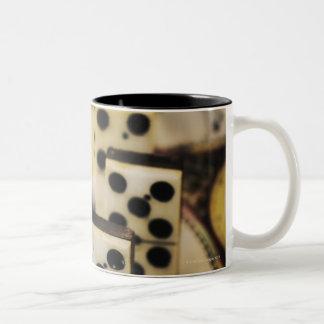 Row of dominoes on old world map Two-Tone coffee mug