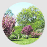 Row of Flowering Trees Round Sticker