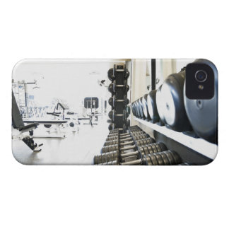 Row of free weights in foreground and exercise iPhone 4 Case-Mate case