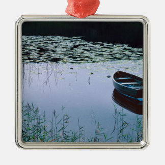 Rowboat on small lake surrounded by water christmas ornament