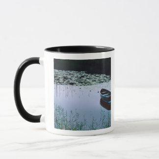 Rowboat on small lake surrounded by water mug