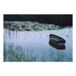 Rowboat on small lake surrounded by water photo print