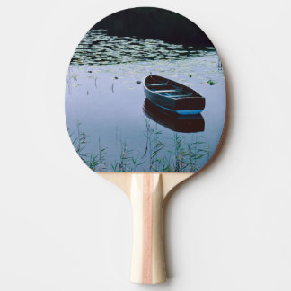 Rowboat on small lake surrounded by water ping pong paddle