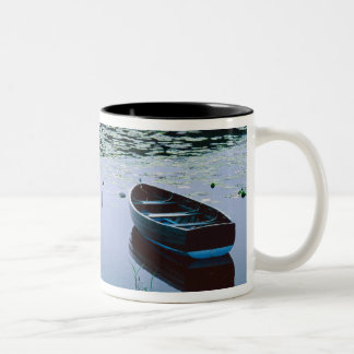 Rowboat on small lake surrounded by water Two-Tone coffee mug