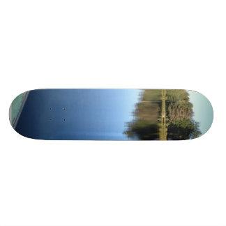 Rowing Boat On Still Lake Skateboards