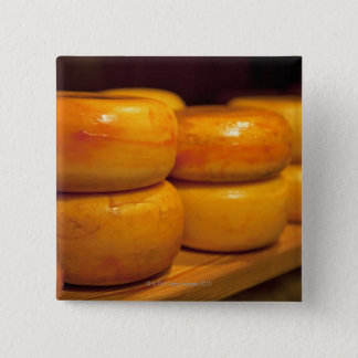 rows of colourful yellow Edam cheeses lined up 15 Cm Square Badge