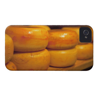 rows of colourful yellow Edam cheeses lined up iPhone 4 Cases
