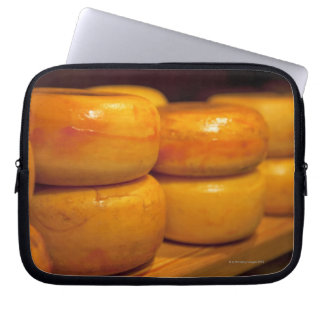 rows of colourful yellow Edam cheeses lined up Laptop Sleeve