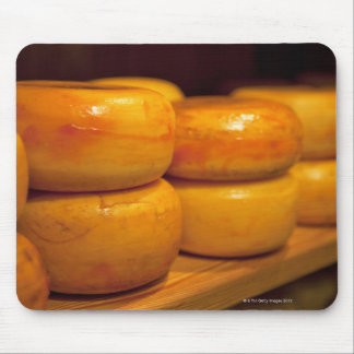 rows of colourful yellow Edam cheeses lined up Mouse Mat