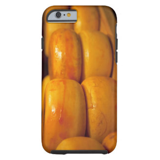rows of colourful yellow Edam cheeses lined up Tough iPhone 6 Case