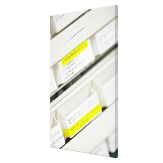 Rows of labeled medicine drawers canvas print