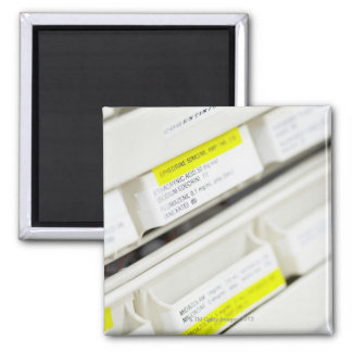 Rows of labeled medicine drawers magnet