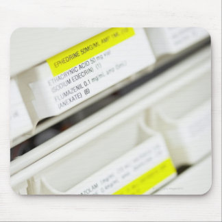 Rows of labeled medicine drawers mouse mat