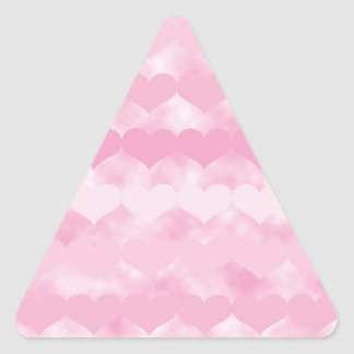 Rows of Pink Hearts Pattern on Pink Cloudy Design Triangle Sticker