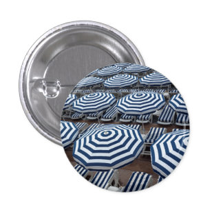Rows Of Striped Beach Umbrellas With Sun Beds 3 Cm Round Badge
