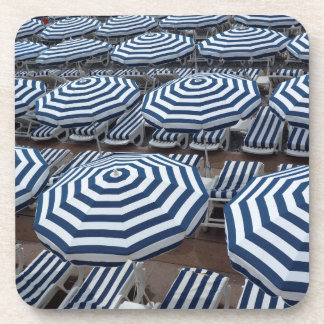 Rows Of Striped Beach Umbrellas With Sun Beds Drink Coasters