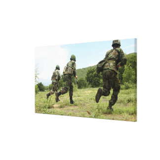 Royal Thai Marines rush forward to secure the s Canvas Print