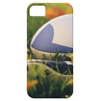 Rugby ball and shoe on lawn in autumn iPhone 5 covers