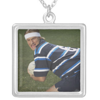Rugby player getting shirt pulled silver plated necklace