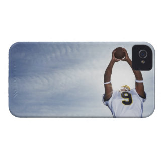 rugby player holding ball up with body stretched iPhone 4 case