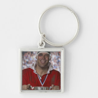 Rugby player holding trophy cup, portrait key ring