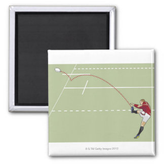 Rugby player kicking ball into touch, dotted magnet
