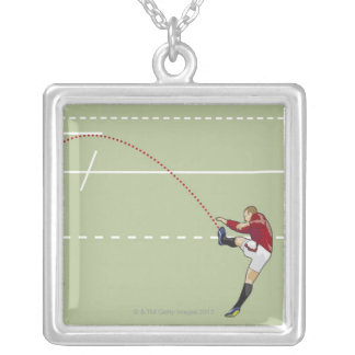 Rugby player kicking ball into touch, dotted silver plated necklace