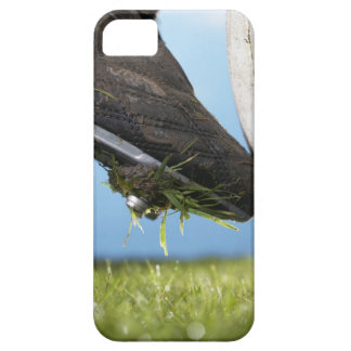 Rugby player kicking ball off tee, close up of iPhone 5 case