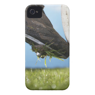 Rugby player kicking ball off tee, close up of Case-Mate iPhone 4 case