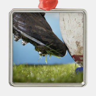 Rugby player kicking ball off tee, close up of christmas ornament