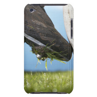 Rugby player kicking ball off tee, close up of iPod touch covers