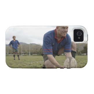 Rugby player positioning ball on rugby pitch vibe iPhone 4 covers