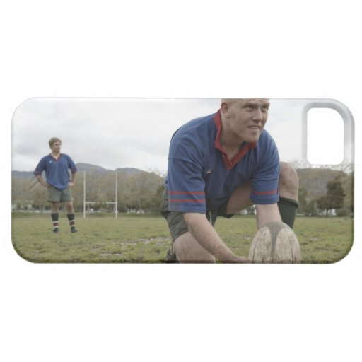 Rugby player positioning ball on rugby pitch iPhone 5 covers