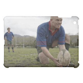 Rugby player positioning ball on rugby pitch cover for the iPad mini