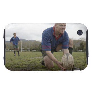Rugby player positioning ball on rugby pitch iPhone 3 tough case