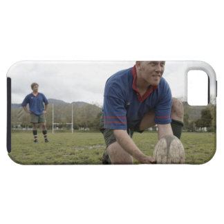 Rugby player positioning ball on rugby pitch iPhone 5 cases